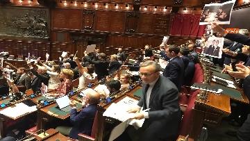 6 - Caso Russia, protesta del PD in Aula, i dem alzano foto di Salvini e Savoini insieme