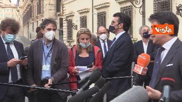 2 - Il presidente del Consiglio Giuseppe Conte risponde alle domande dei giornalisti fuori Chigi, le foto