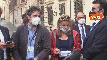 9 - Il presidente del Consiglio Giuseppe Conte risponde alle domande dei giornalisti fuori Chigi, le foto